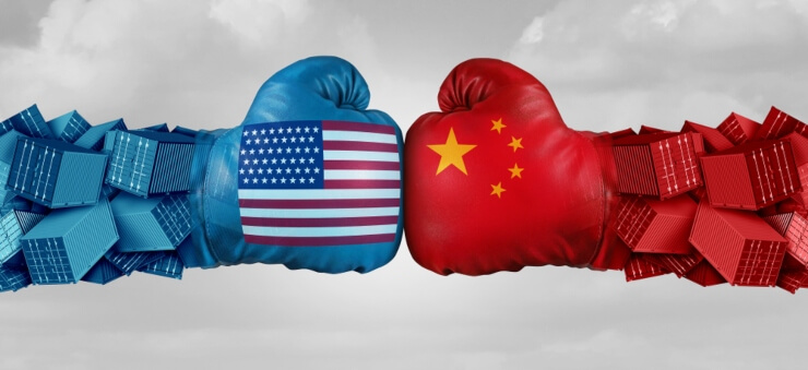 fist bump between boxing gloves depicting US and China flag