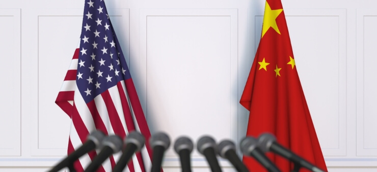 microphones pointed at US and China flags in conference setup