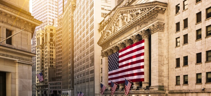 Wall Street buildings with US flags