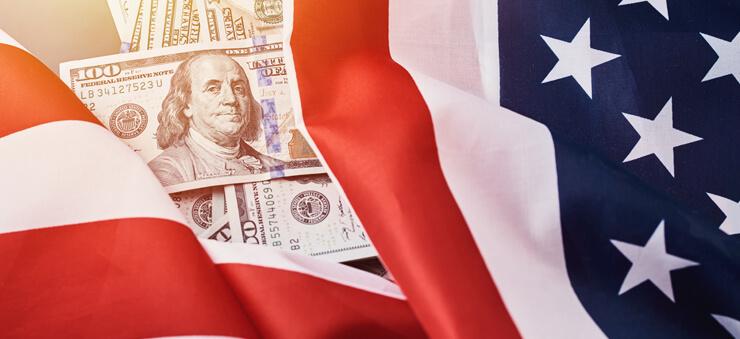dollar bills and American flag
